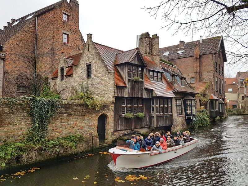 Tourist Boat Trip Boat Tourists Belgium Bruges Canals And Waterways Architecture Building Exterior Built Structure Outdoors Water Day Large Group Of People Nautical Vessel