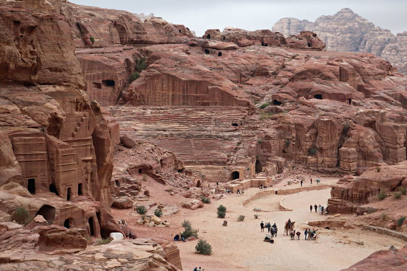 High angle view of people and animals by rock formations
