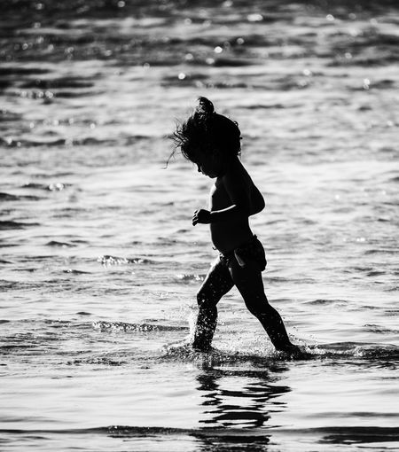 Child emotion Sommergefühle Water Real People One Person Sea Leisure Activity Full Length Motion Lifestyles Outdoors Nature Fun Waterfront Day Ankle Deep In Water Extreme Sports Standing Beach Sport Wave Young Adult Elafonisi Crete EyeEm Selects Black And White Friday 2018 In One Photograph Women Beauty In Nature Adult People