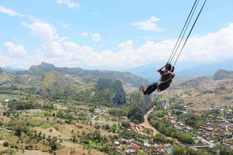 View Of Man Paragliding
