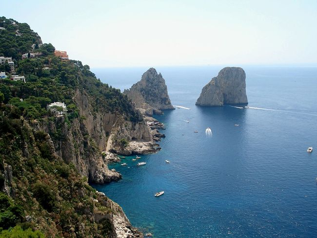 Capri, Italy Crag Cragside Cliff Cliffs Rocks Rocks And Water Water Water Reflections Boats Landscape Landscape_Collection Landscape #Nature #photography Italy Nature Naturelovers Coast Coastline Trees Colour Of Life Travel View From Above View Outdoor Photography Green Beauty In Nature