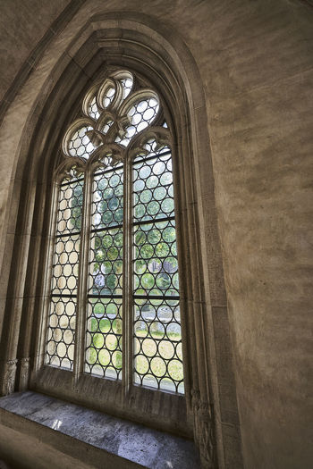 Low angle view of glass window in historic building