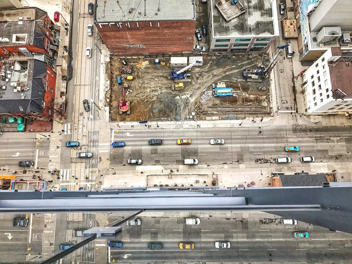 Aerial view of vehicles on road in city
