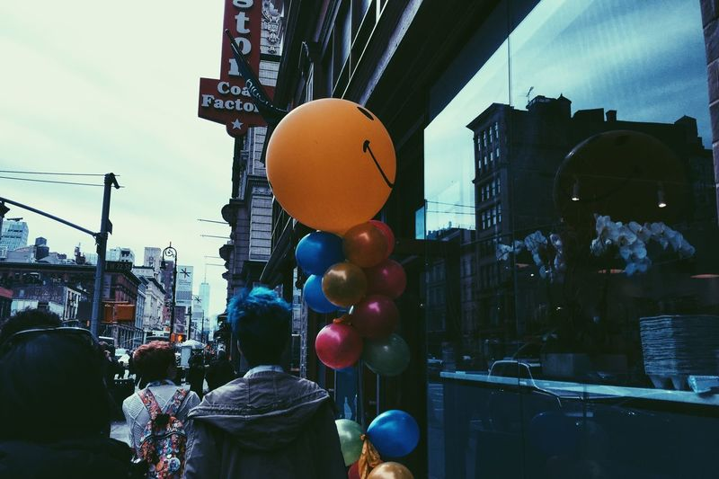 Balloon City Multi Colored Helium Balloon Real People Casual Clothing Rear View Built Structure Architecture Building Exterior Sky Day One Person Outdoors