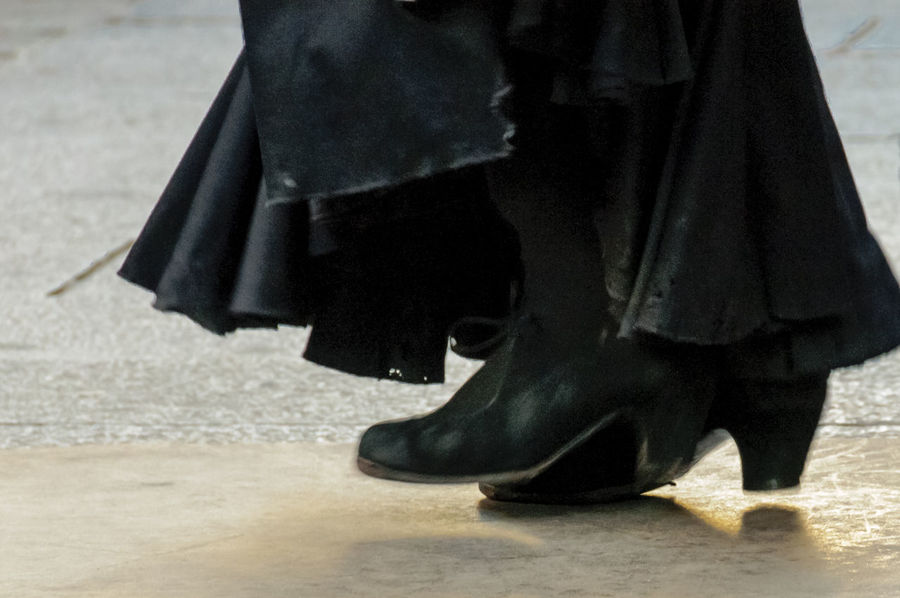 A close view of a pair of female black flamenco shoes who was street performing in in Madrid. Black Shoes Black Skirt Dancer Editorial  Editorialphotography Entertainment Flamenco Real People Shoe Street Entertainment Streetphotography Travel Woman Women