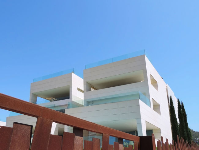 Building exterior of a home or house, modern architecture. Architecture House Facade Houses Modern Modern Architecture Architecture Blue Building Building Exterior Building Exteriors Built Structure City Clear Sky Copy Space Day House House Facades Low Angle View Modern Nature No People Outdoors Sky Sunlight Villa