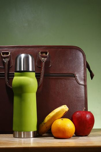 Water, apple, orange, banana and a briefcase. Portfolio Bag Attache Briefcase Diet Bottle Fitness Snack Health Lunch Diet & Fitness Healthy Eating Healthy Lifestyle Nutrition Food And Drink Beverage Drinking Drink Orange Banana Apple Caffeine Coffee Break Coffee Time Coffee