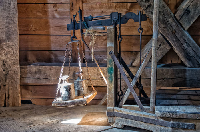 Historic Decimal Scale as used in a Windmill Heavy Scale  Sunlight Weighing Scale Windmill Conventional Decimal Decimal Scale Equipment Germany Historic Industry Instrument Justice Metal Mill Old Scales Sunlit Timber Tool Weighing Weight Wood Wood - Material