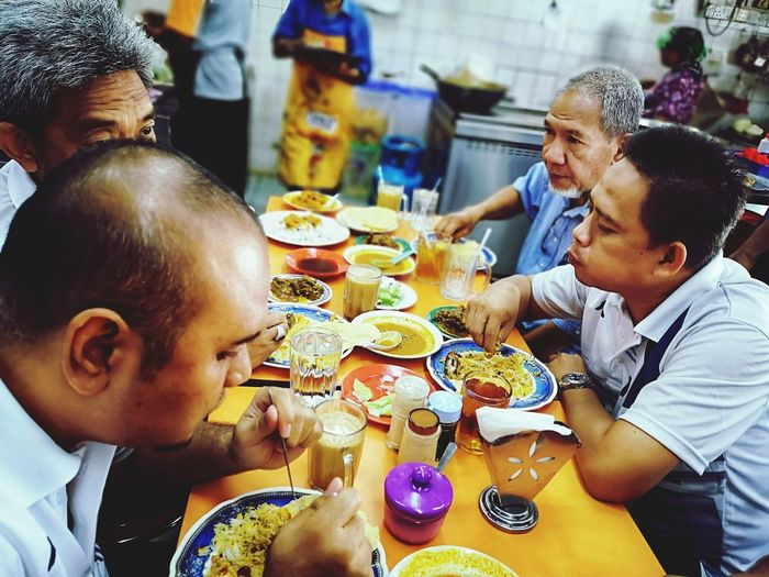 People's eating Attractions❤️ Color Selective Focus Unknown People Malaysian Food ASIA Malaysia Scenery Object Friendship Eating Dinner Party Togetherness Males  Sitting Men Happiness Boys Male Friendship Prepared Food Happy Hour Celebratory Toast After Work