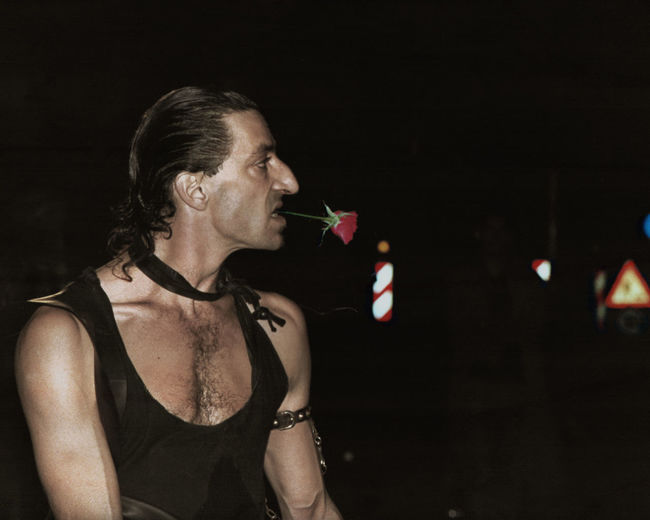 The Motorised Chevalier With The Rose In His Teeth (1990) Optimised Scan of a then published Photo. 1990 Analogue Photography Photoshop Edit Proud Traffic Signs Adult Adults Only Black Background Focus On Foreground Improvedimage Indoors  Leather Vest Night One Person Performance Rosé Scan Theatre Young Man