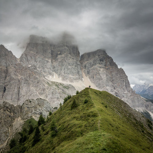 Scenic view of dolomites mountains against cloudy sky
