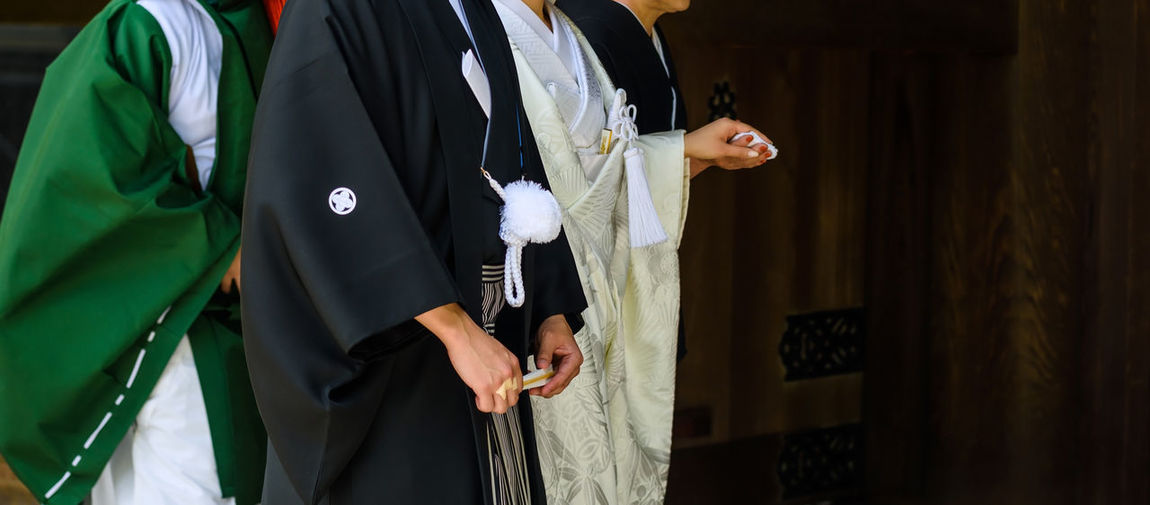 Midsection of females in traditional clothing at temple