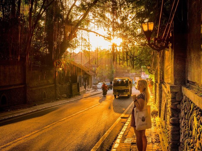 Golden hour - downtown Ubud Bali Bali, Indonesia Ubud Ubud, Bali Golden Hour Girl Sunset Tropical Climate Tropical Streetphotography Street Road ASIA Holiday Travel Destinations Outdoors Holiday Memories Baliphotography Balinese Ubud Village Mode Of Transportation Real People Lifestyles Walking Vacations EyeEmNewHere