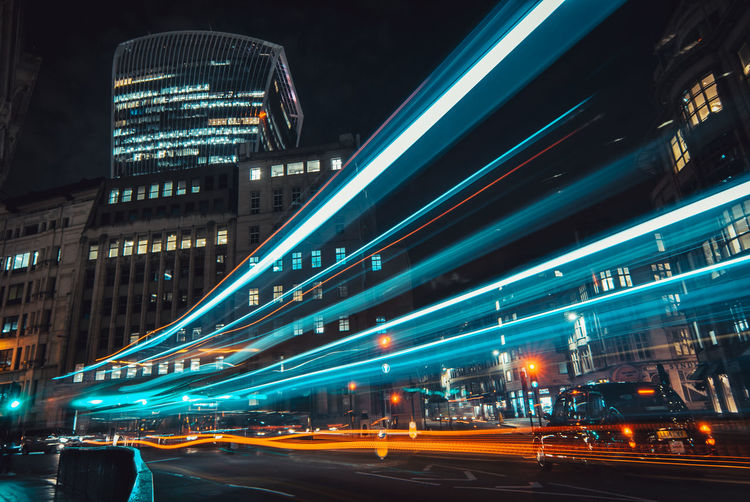 Illuminated city street and modern buildings at night