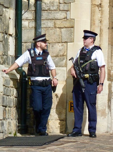 Windsor Castle security Royal Wedding Royalty Police Windsor Castle Uniform Police Force Standing Protection Law Men Occupation Headwear Boys Weapon Military Uniform Protective Workwear Police Uniform People Building Exterior Adult Day Built Structure Togetherness Outdoors