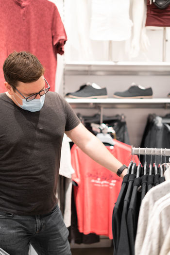 Midsection of man standing in store