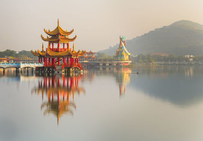 Beautiful morning sunlight over Lotus Pond in Kaohsiung, Taiwan. Gold Kaohsiung Pagoda Pond Taiwan Architecture Budism Budist Tempel Built Structure Formosa Golden Hour Lake Landscape Mountain Nature Outdoors Reflection Scenics Sky Temple Water Waterfront