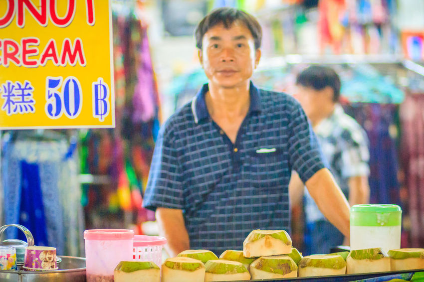 Bangkok, Thailand - March 2, 2017: Unidentified coconut vendor selling coconut fresh fruits and coconut ice cream at Khao San Road night market, Bangkok, Thailand. Coconut Khao San Rd Khao San Road KhaoSan Khaosan Rd. Khaosandroad Tourist Tourist Attraction  Tourists Adult Business Casual Clothing Day Focus On Foreground Food Food And Drink Freshness Front View Healthy Eating Ice Cream Incidental People Khao San Khao San Knok Wua Khao San Rd. Khaosan Road Khaosanroad Market Market Stall Night Market Night Market In Thailand Night Market, One Person Real People Retail  Retail Display Small Business Standing Tourist Destination Waist Up