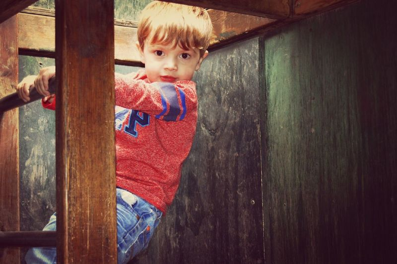 Climbing frame Childhood One Person Wood - Material Casual Clothing Children Only Child Day Standing Indoors  People Blond Hair One Boy Only Warm Clothing Close-up The Week On EyeEm Taking Photos EyeEm Selects Outdoors Portrait Playing Looking At Camera