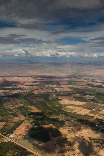 Aerial Aerial Photography Aerial View Agricultural Land Day Epic Far Sight High Angle View Human In Nature Landscape Nature No People Outdoors Over The Clouds Shapes Surface Tranquility Travel Destinations World From Above