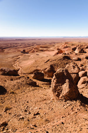 A four by four offroad oldtimer parking next to a big round stone in a stone desert in Moroco. 4x4 Africa Arid Climate Beauty In Nature Bleak Camping Car Day Desert Desert Dry Hill Landscape Morocco Nature Off-Road Outdoors Overland Rocks Scenics Sky Sparse Stone Tranquility Vehicle