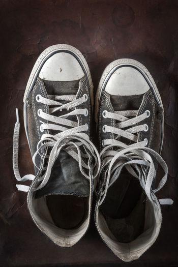 High angle view of shoes on hardwood floor