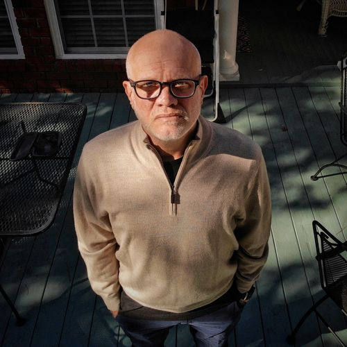 Serious Self Portrait EyeEm Selects Eyeglasses  One Person Glasses Real People Looking At Camera Front View Men Adult Portrait Mature Adult Completely Bald Mature Men Males  Casual Clothing Leisure Activity Waist Up