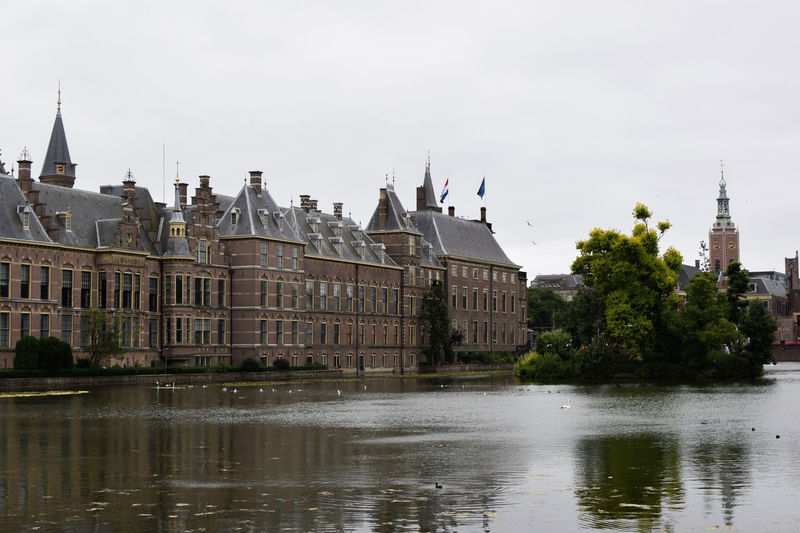 The most beautiful spot in Haag Architecture Business Façade Netherlands Reflection Travel Architecture Building Building Exterior Built Structure City Clouds Day Dutch Europe Landscape Nature No People River Roofs Sky Travel Destinations Tree Water Window