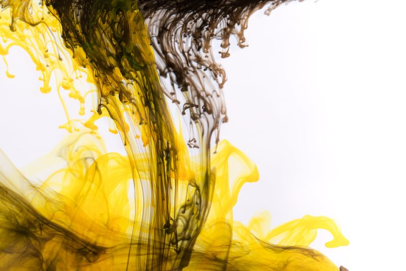 yellow ink with black drops EyeEm Nature Lover Nature Abstract Backgrounds Close-up Copy Space Drink Drop First Eyeem Photo Flowing Freshness Indoors  Ink Mixing Motion Nature_collection No People Pattern Purity Refreshment Splashing Studio Shot Water White Background Yellow Visual Creativity