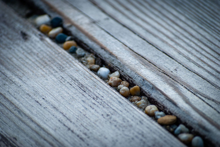 Close-up of wood and gravel