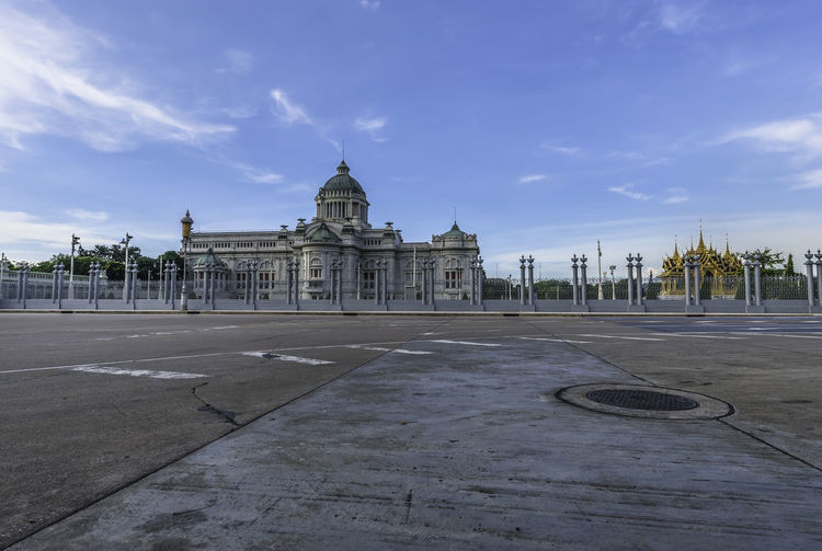 Ananda Samakhom Throne Hall with Reflection Bangkok Thailand Architectural Column Architecture Building Building Exterior Built Structure City Cloud - Sky Courthouse Day Dome Government History Nature Neo-classical No People Outdoors Road Sky Street The Past Tourism Travel Travel Destinations