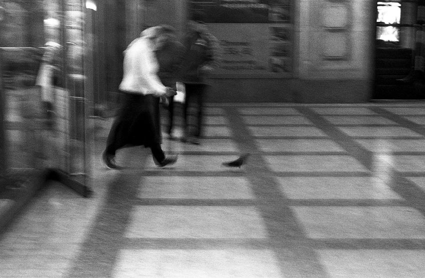 """""""How to banish a pigeon from bakery"""". 35mm Film Art Is Everywhere Bakery Black And White Blurred Motion Exakta 3.5-4.5/35-70mm EyeEm Diversity Film Photography Hbf Leipzig Motion Pigeon Real People Agfa APX 400 AgfaPhoto APX 400 (new) The Street Photographer The Street Photographer - 2017 EyeEm Awards"""