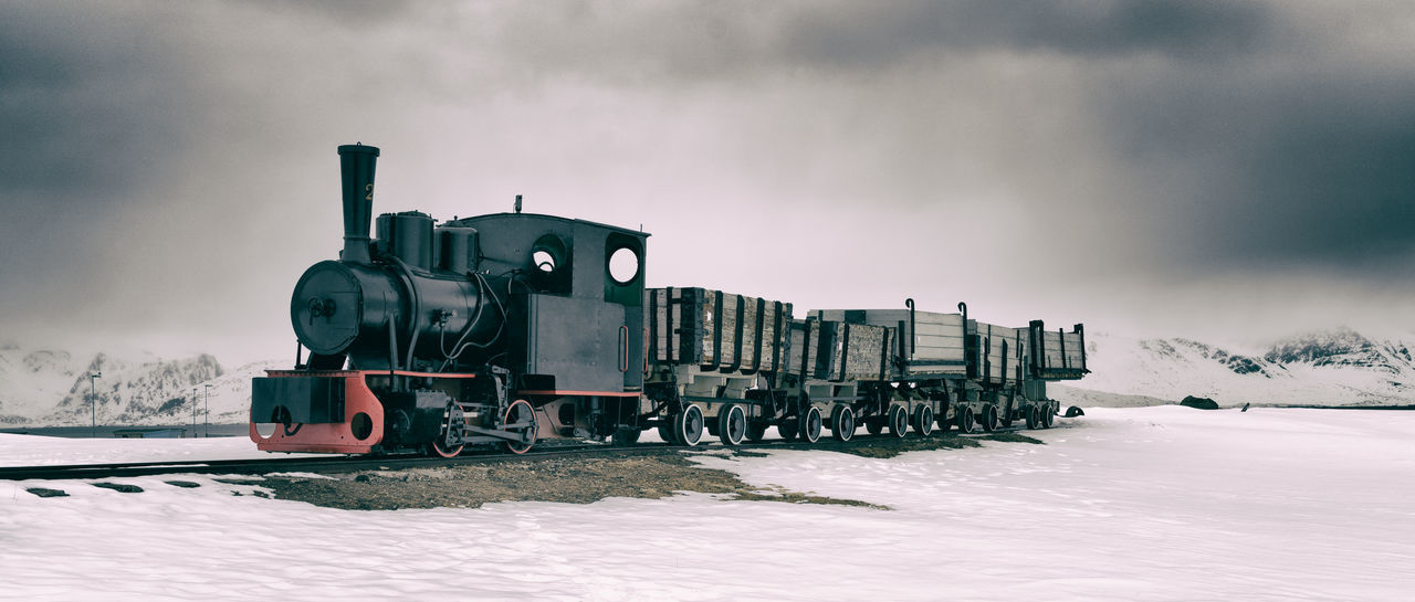 Old coal-train in Ny Alesund, Svalbard Cloud - Sky Coal Coal Mine Cold Temperature Day Historic Landscape Locomotive Mode Of Transport Nature No People Ny Alesund Old Outdoors Rail Transportation Railroad Track Sky Snow Steam Train Svalbard  Train - Vehicle Transportation Weather Winter