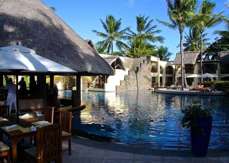 Architecture Belle Mare Plage Blue Clear Sky Enjoying Life Hello World Hotel Lunchtime Mauritius Palm Trees Poolbar Poolside Reflection Relaxing Sky Sunbeds And Umbrella Sunshade Swimming Table And Chairs Take Your Place Taking Photos Vacations Restaurant Wine Moments Wineandmore