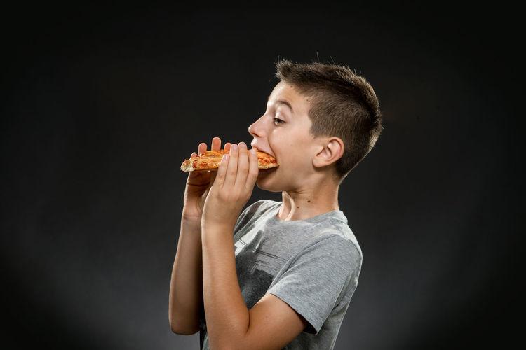 ten years boy eats a slice of pizza Happy Boy Hungry Pizza Time Pizza Time🍕 Boy Eating Pizza Happy Pizza Hungry Boy Pizza Slice Of Pizza Ten Years Boy Ten Yeras Old