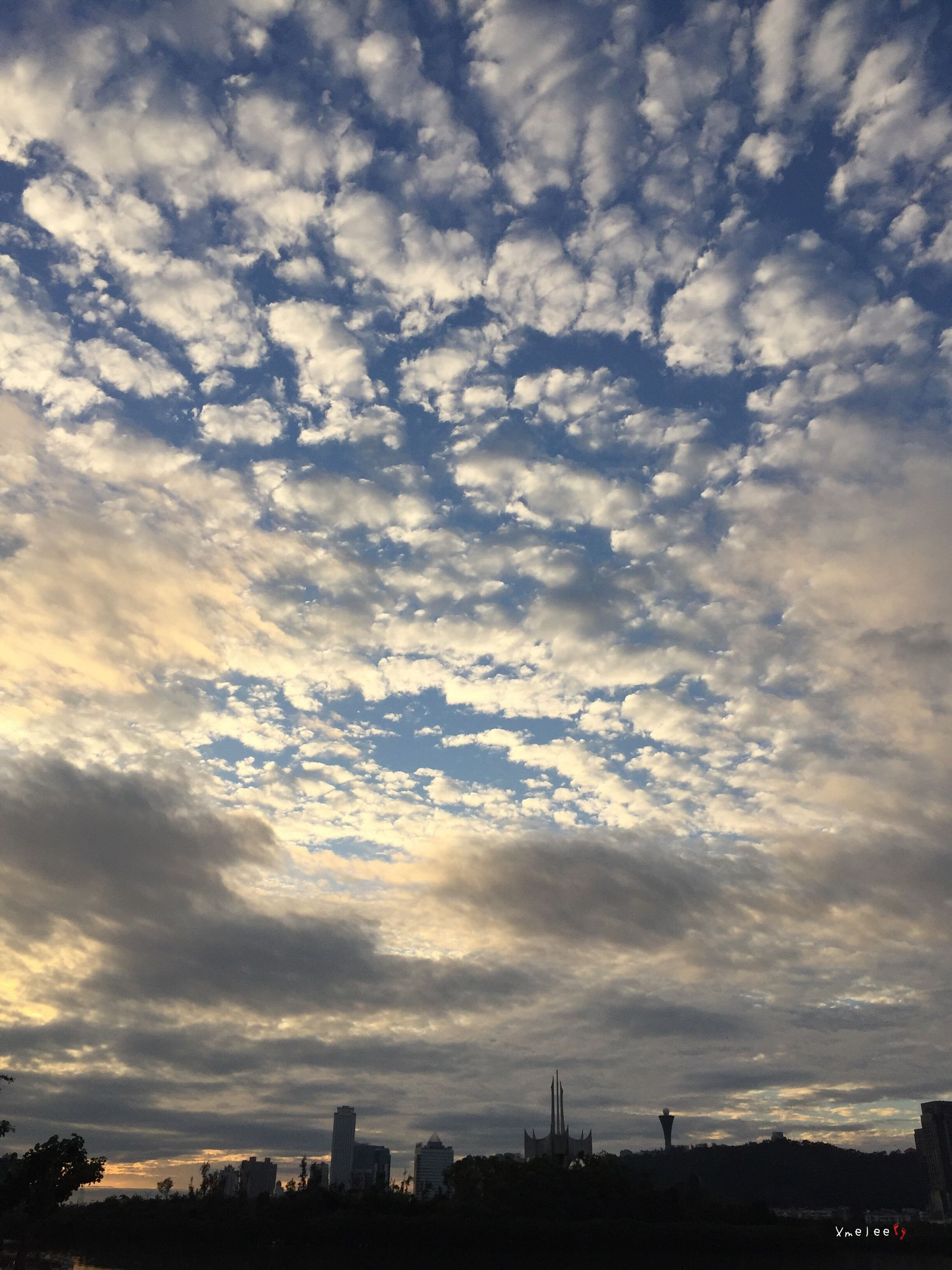 cloud - sky, sky, silhouette, sunset, outdoors, nature, no people, dramatic sky, low angle view, scenics, tree, beauty in nature, city, urban skyline, architecture, cityscape, day