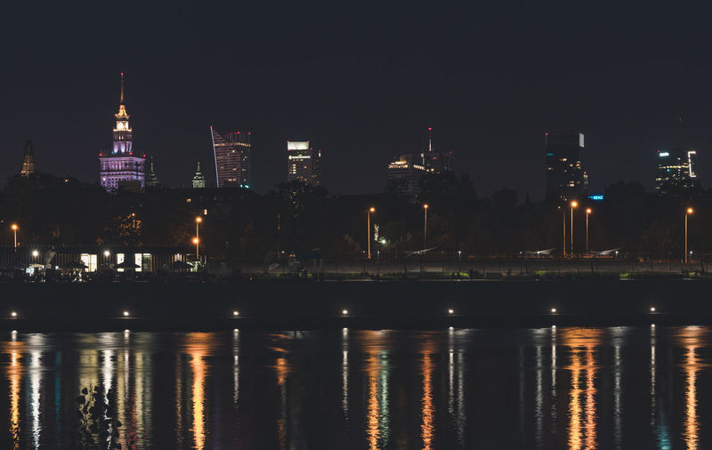 Night panorama of Warsaw skyline over Vistula river. Beautiful Cityscape Light Nightphotography Vistula River Warsaw Poland Architecture Built Structure City Colorful Illuminated Long Exposure My City Night Outdoors Reflection Skyscraper Travel Destinations Urban Waterfront