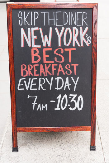 Cafe advertising in the street in NYC Coffee Breakfast Advertising Retro Vintage Chalkboard Text Communication Western Script Sign Information Information Sign Board No People Blackboard  Capital Letter Message Close-up Day Advertisement Red Black Color Placard Hanging White Color Wood - Material Menu