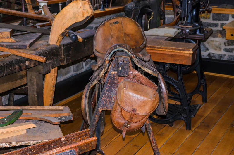 Saddle on wood in workshop