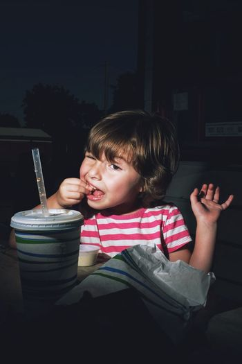 Girl Having Food In Cafe At Night