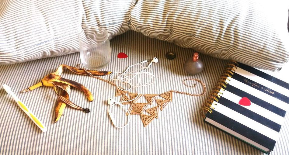 High Angle View Of Various Objects On Bed