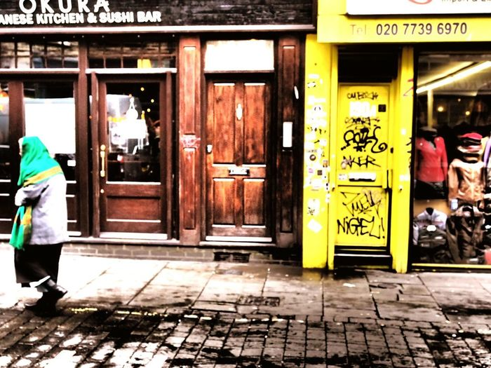 Street Photography Brick Lane Graffiti Graffiti Art Shop Window Old Woman Woman Walking Woman Walking On The Street Shawl Colorful Colour Of Life