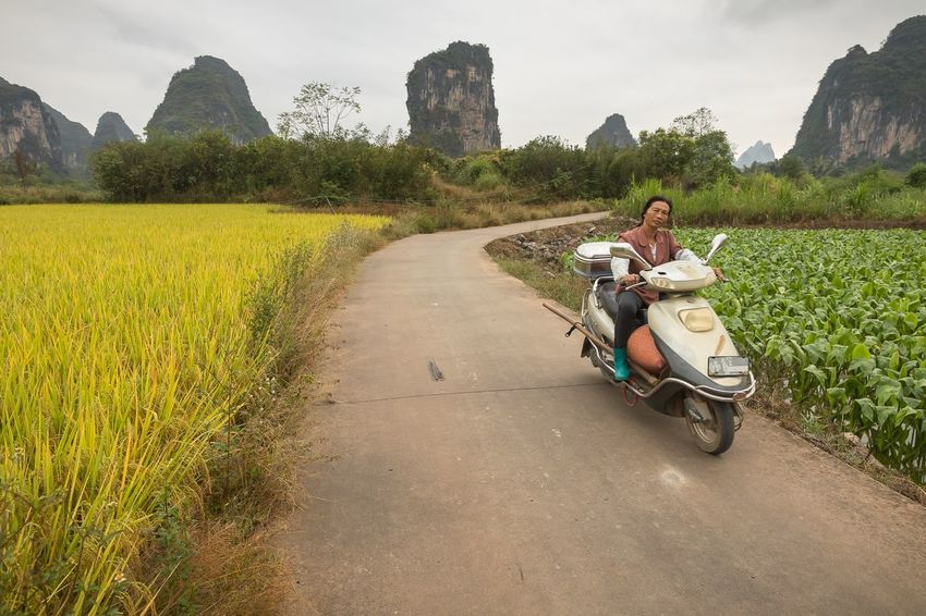 Beautiful landscape in the Guangxi región near Yangshuo China. Yangshuo China Documentary Storytelling Streetphotography People Transportation Mode Of Transportation Real People One Person Road Nature Travel