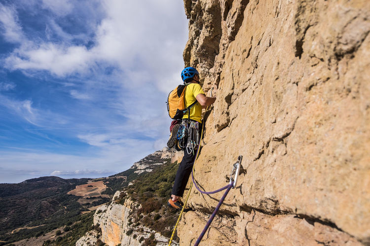 Climbing in Vilanova de Meia Adventure Climbing Extreme Sports Sport Helmet Mountain Rock Rock Climbing Leisure Activity Headwear Mountain Climbing Sports Helmet Rope Nature Safety Harness Outdoors Effort RISK Safety Climbers Finding New Frontiers Risky Business Brave