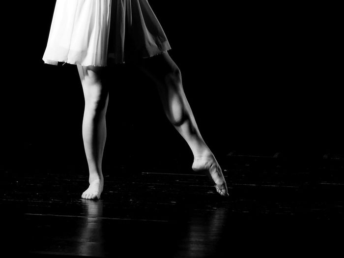 Low section of ballet dancing on stage