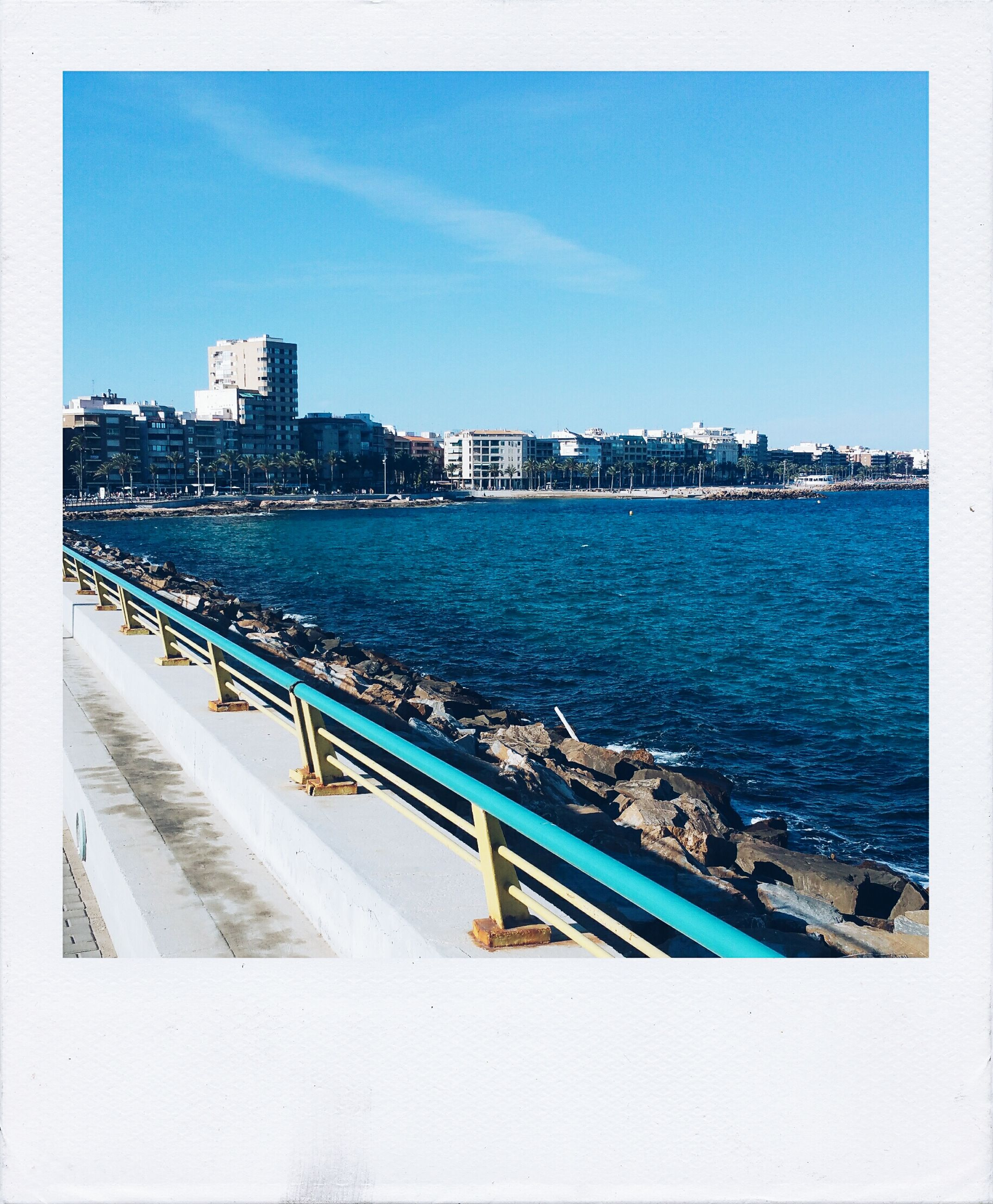 sea, beach, sky, sand, city, building exterior, no people, outdoors, built structure, clear sky, architecture, day, water, urban skyline, scenics, horizon over water, snow, nature, cityscape