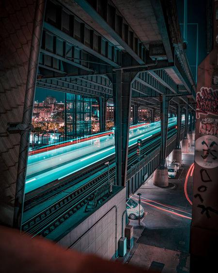 Illuminated train in city at night