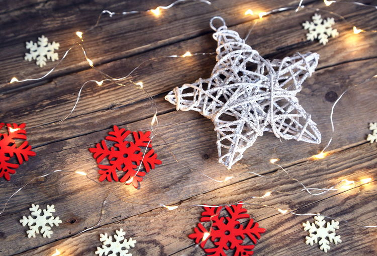 Background Celebration Christmas Christmas Decoration Christmas Ornament Christmas Tree Close-up Day Eco Holiday - Event Indoors  Lights Natural Night No People Planks Red Snowflake Star Shape Tradition Wallpaper Warm White Winter Wood - Material