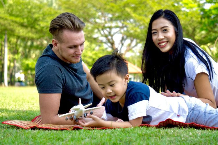 Child Boys Grass Males  Smiling Playing Education Son Outdoors Lifestyles People Learning Nature Friendship Togetherness Men Family Cheerful Childhood Day