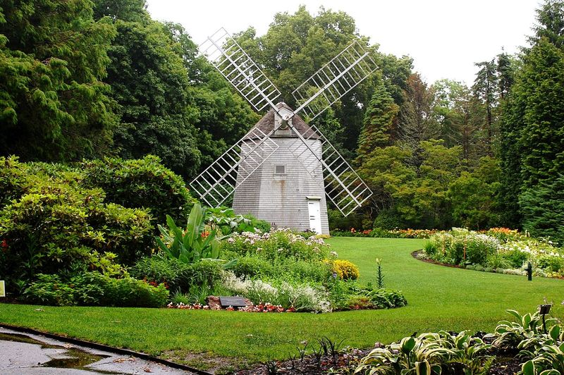Windmill at Heritage Museums and Botanical Gardens. Botanical Gardens Windmill EyeEmNewHere Day Green Color Tree Outdoors Growth Grass No People Nature Architecture